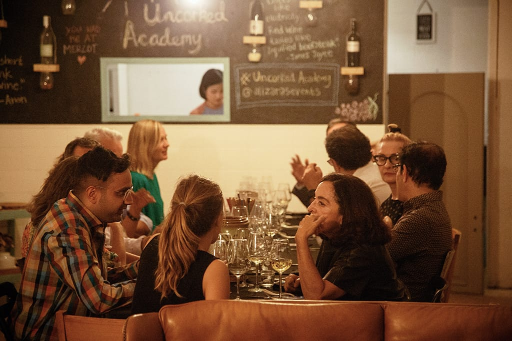 Supperclub Diners Enjoying Vietnamese Food and Wine Pairing Dinner at Uncorked Academy in Barcelona