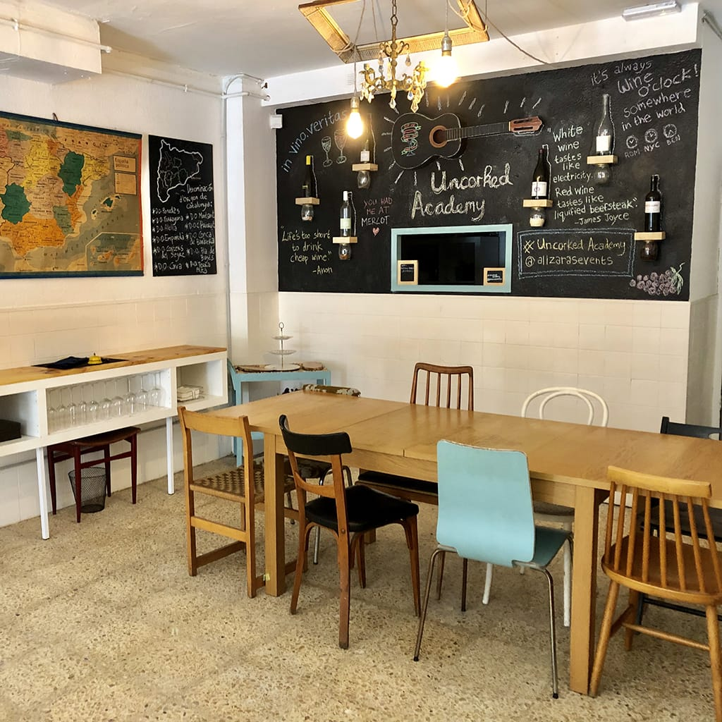 View of Wine Tasting Table with Chairs and Grafitti Blackboard